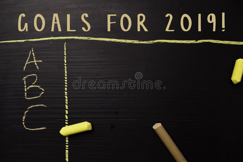 Goals For 2019! written with color chalk. Supported by an additional services. Blackboard concept stock images