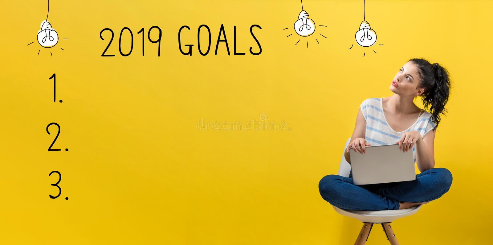 2019 goals with woman using a laptop stock images