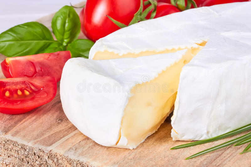 Goat cheese, cherry tomato, and basil stock image