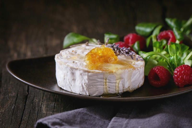 Goat cheese with honey and raspberries stock image