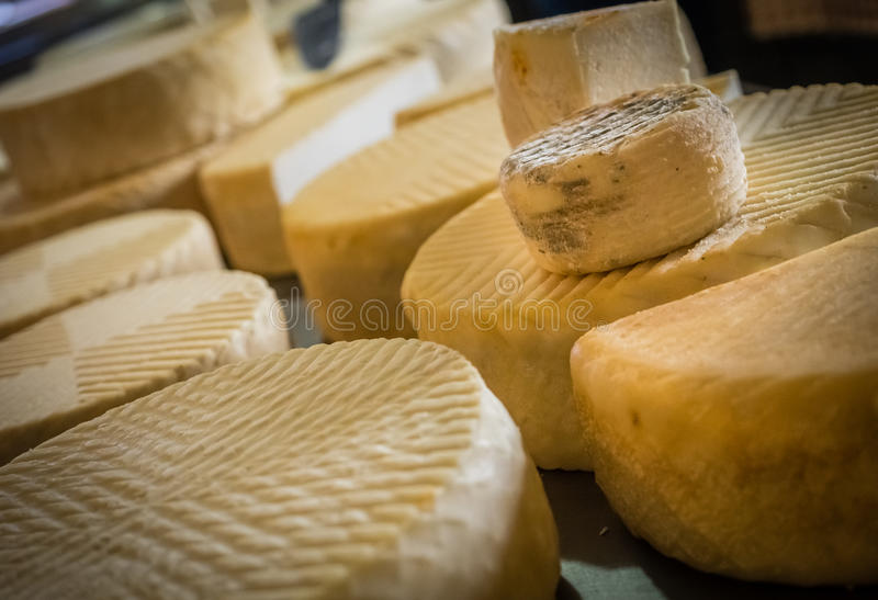 Goat cheese on sale. Large chunks of goat cheese on sale in a farm shop in Fuerteventura, Canary Islands, Spain stock photos