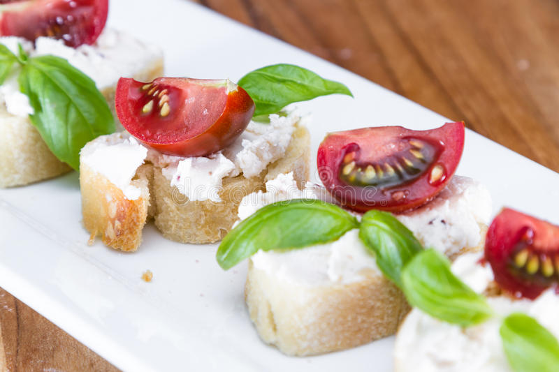 Goat cheese and tomato appetizer stock photo