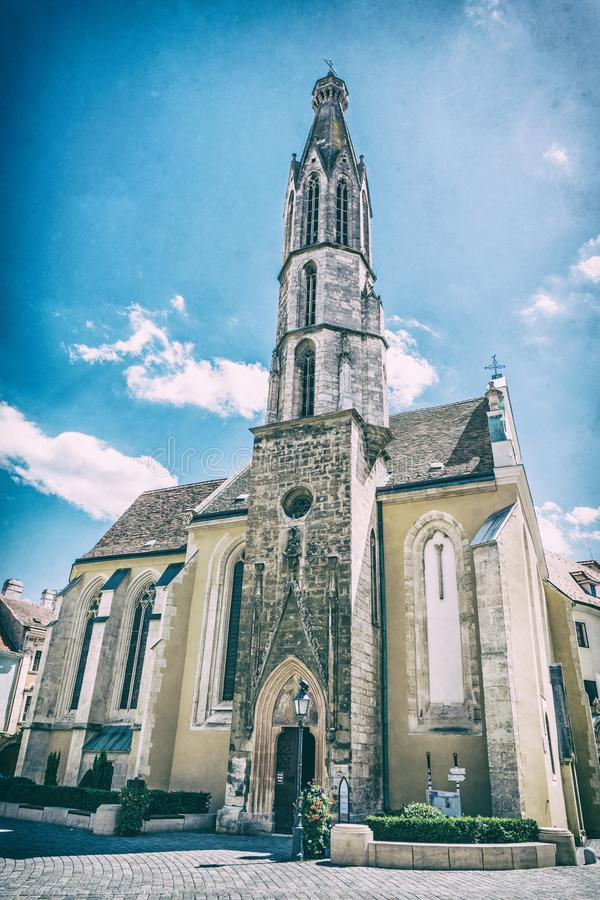 Goat church in Sopron, Hungary, analog filter. Goat church in Sopron, Hungary. Religious architecture. Travel destination. Analog photo filter with scratches royalty free stock images