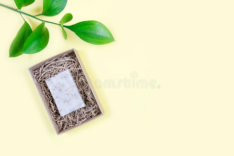 Goat milk soap on a yellow background. Organic cosmetics. Flat lay. Minimalistic composition stock image