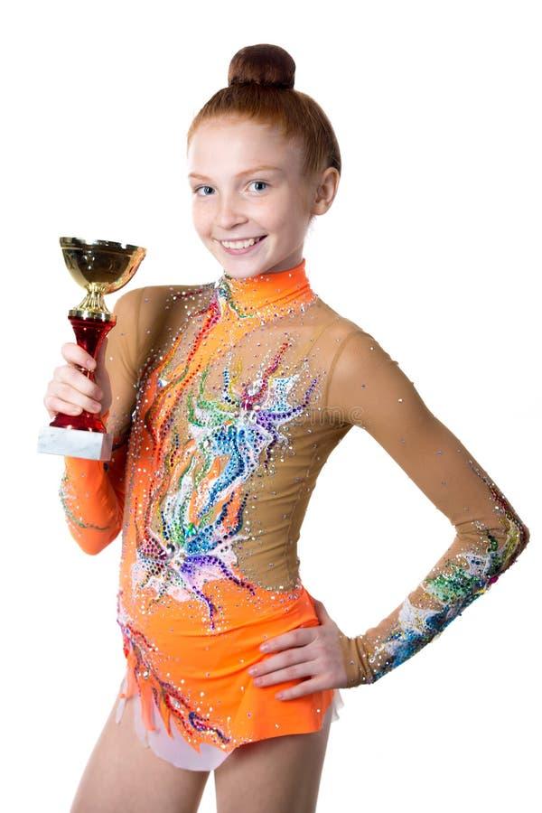 Gobelet d'or de fille d'athlète de gagnant images libres de droits