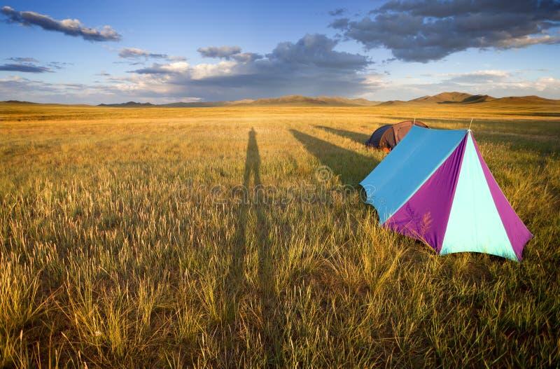 Gobi desert. Camping in the Gobi desert at sunset creating shadows lengthened royalty free stock images
