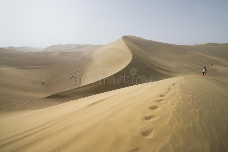 Hike in the Gobi desert. Sand dunes with footprint in the Gobi Desert in China. Gobi Desert, China - 08 07 2016 : Hike in the Gobi desert. Sand dunes with royalty free stock photo