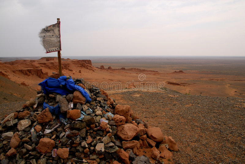 Gobi Desert, Mongolia. An ovoo looknig out over the red sands of the northern Gobi Desert, in Mongolia royalty free stock photo
