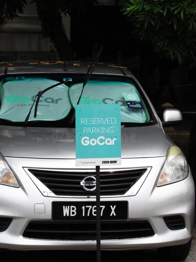 GoCar Reserved Parking Sign In Malaysia. Car sharing company GoCar`s reserved parking sign at the KTM Ipoh Railway Station, Malaysia. Also visible are windscreen stock image