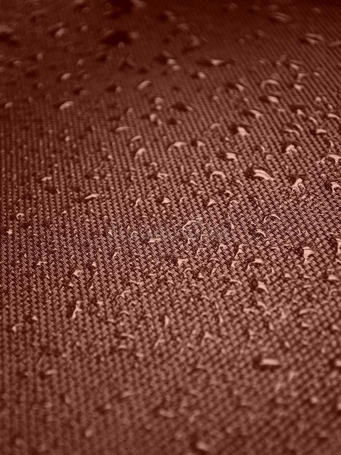 Gocce di acqua su struttura del tessuto fotografia stock