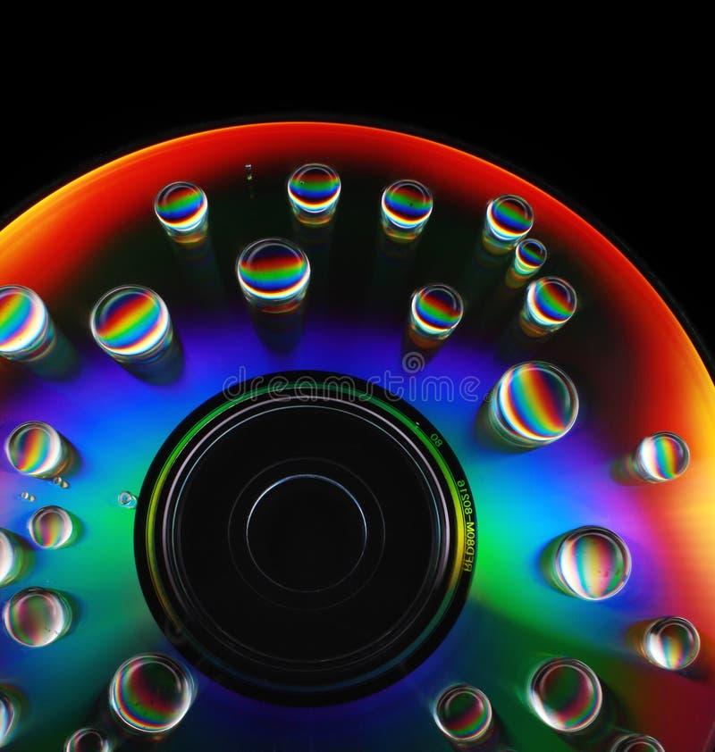 Gocce di acqua su un CD fotografia stock