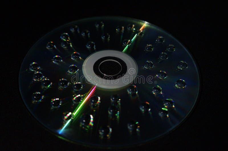 Gocce di acqua sul disco fotografia stock libera da diritti