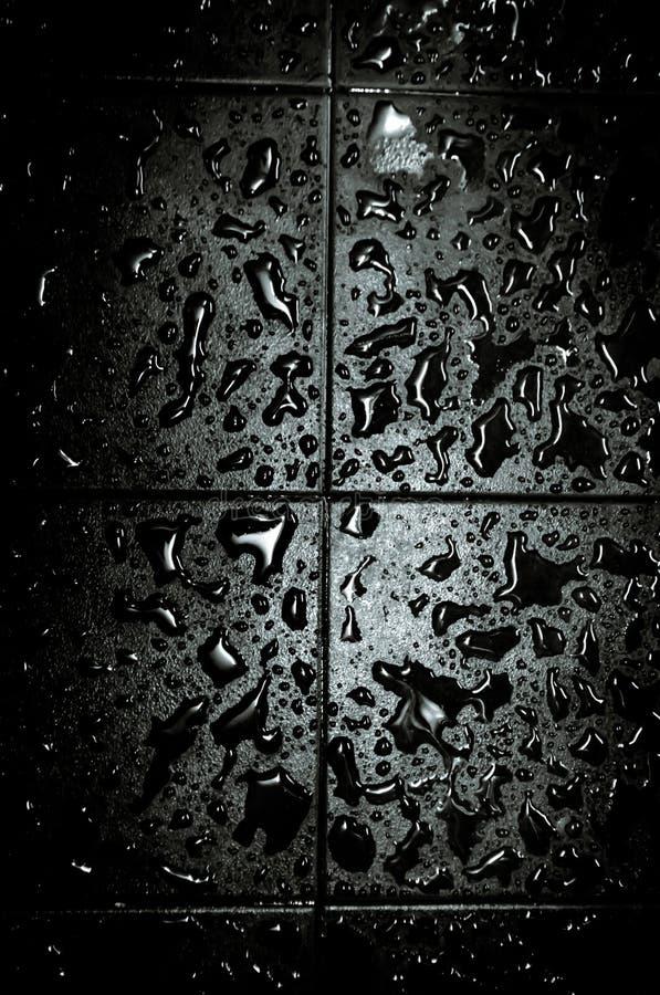 Gocce di acqua sul pavimento fotografia stock