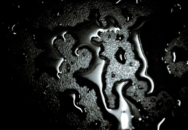 Gocce di acqua sul pavimento immagini stock