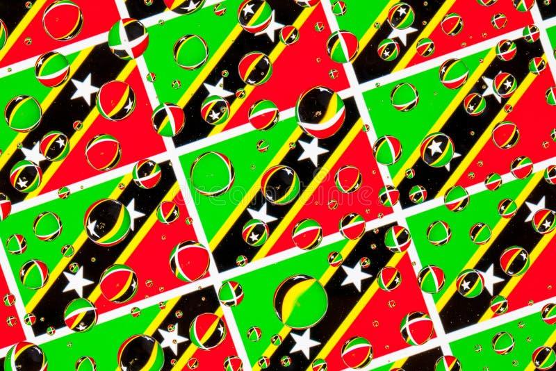 Gocce di pioggia piene delle bandiere di Saint Kitts e Nevis fotografia stock libera da diritti