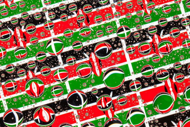 Gocce di pioggia in pieno delle bandiere del Kenya illustrazione di stock