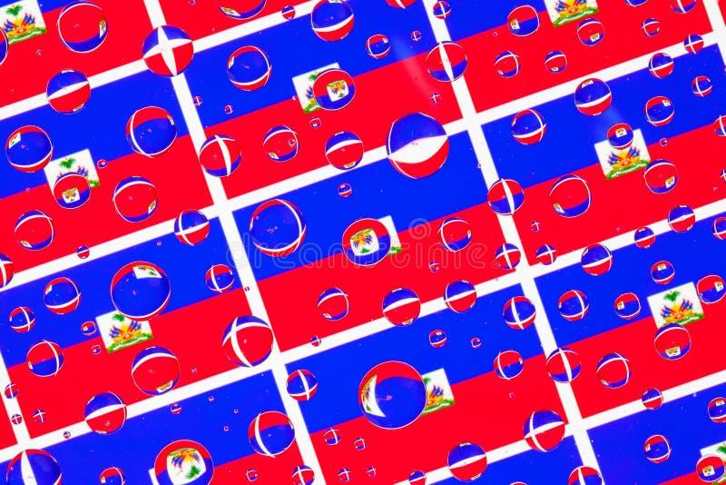 Gocce di pioggia in pieno delle bandiere di Haiti royalty illustrazione gratis