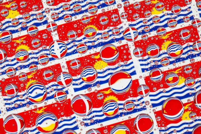 Gocce di pioggia in pieno delle bandiere di Karibati illustrazione vettoriale