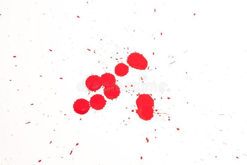 Gocce rosse su bianco immagini stock