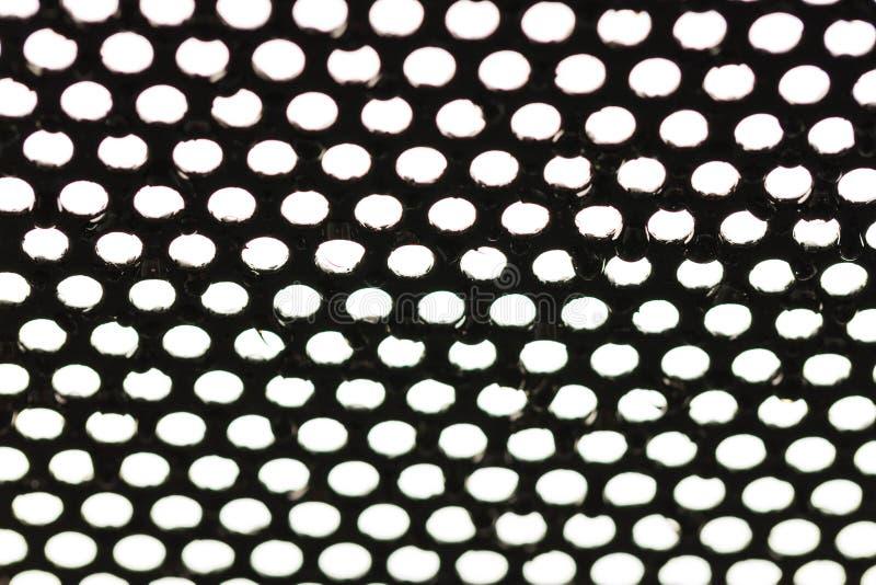 Goccia di pioggia sullo schermo del ferro fotografia stock libera da diritti