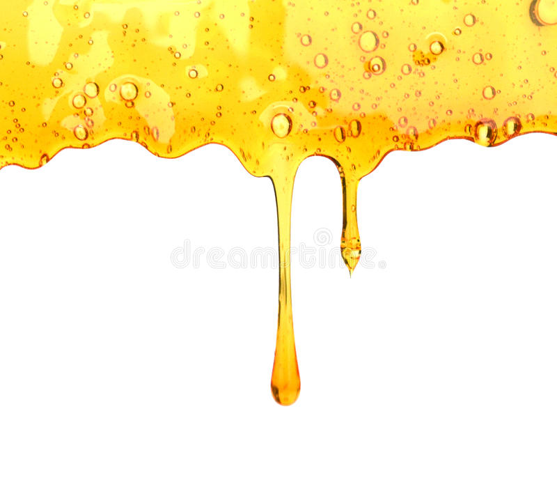 Gocciolamento del miele dal cucchiaio fotografia stock libera da diritti