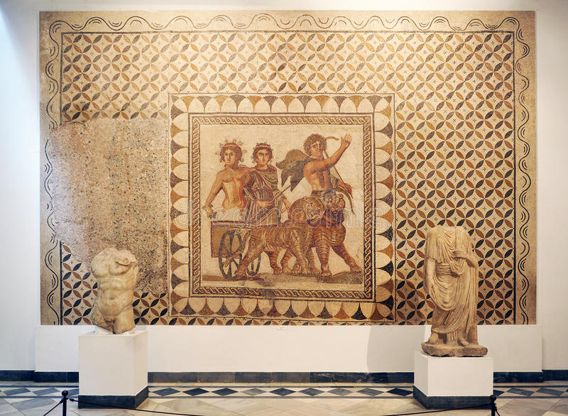 God Bacchus mosaic, Archaeological Museum of Seville, Andalusia, Spain. Sculptures, mosaics and glass cases in the rooms of Roman art, inside the Archaeological royalty free stock image