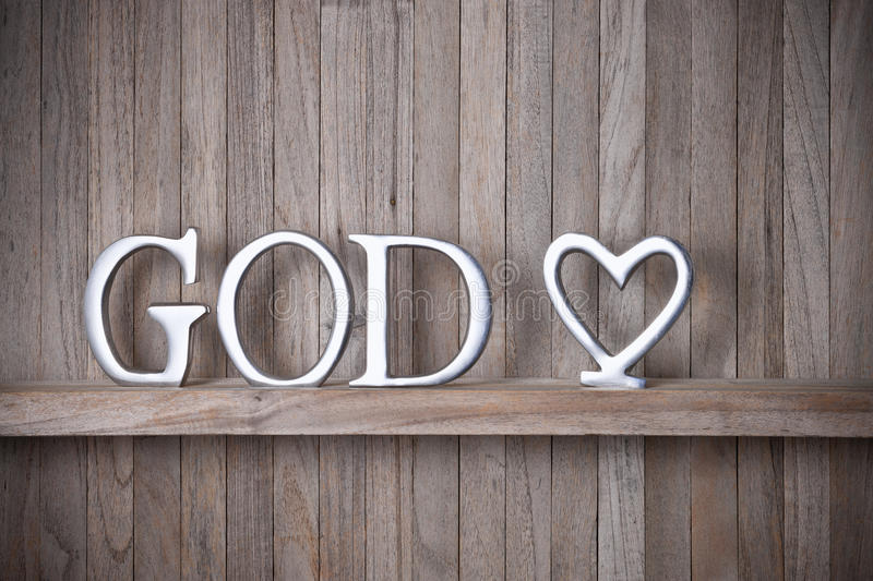 God Christian Love Wood Background. A rustic wood background with the word God on it and a love heart royalty free stock photography