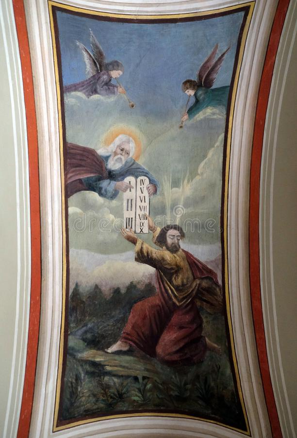 God gives Moses the Ten Commandments. Fresco in the church of Saint Matthew in Stitar, Croatia royalty free stock images