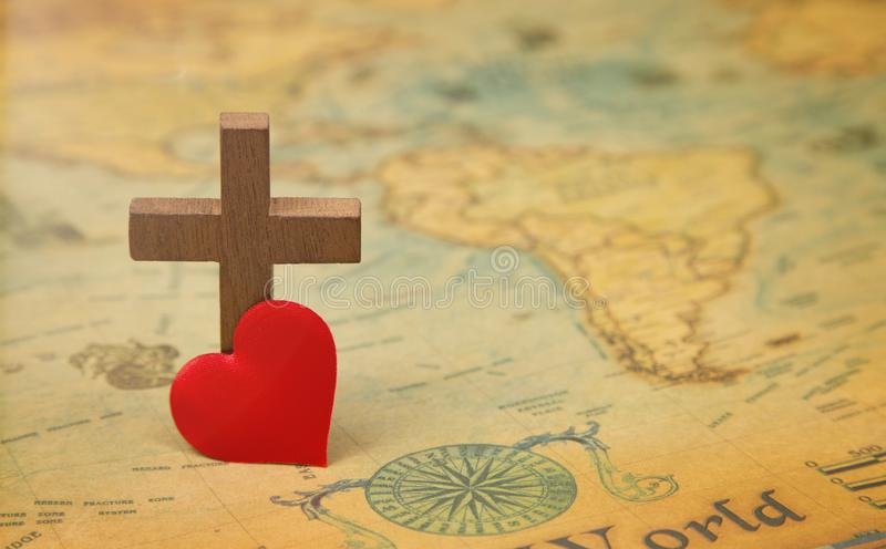 For God so loved the world. A Cross on a rustic world map stock photo