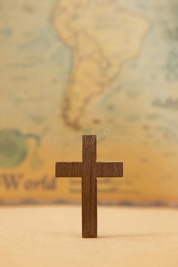 For God so loved the world. A Cross on a rustic world map royalty free stock photos