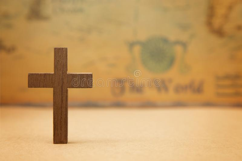 For God so loved the world. A Cross on a rustic world map royalty free stock photography