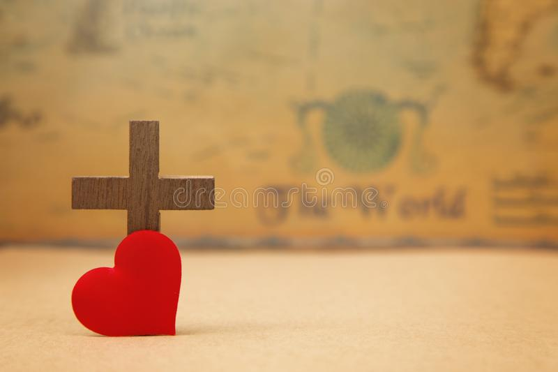 For God so loved the world. A Cross on a rustic world map royalty free stock image