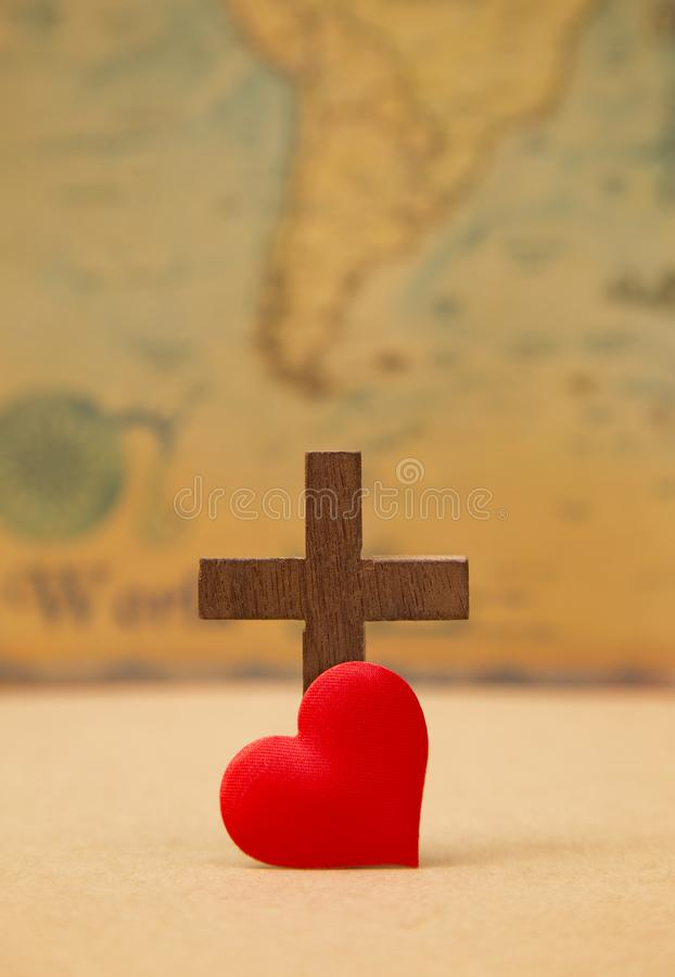 For God so loved the world. A Cross on a rustic world map stock photos