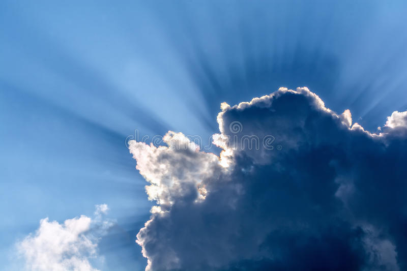God rays. Behind stormy clouds royalty free stock photography