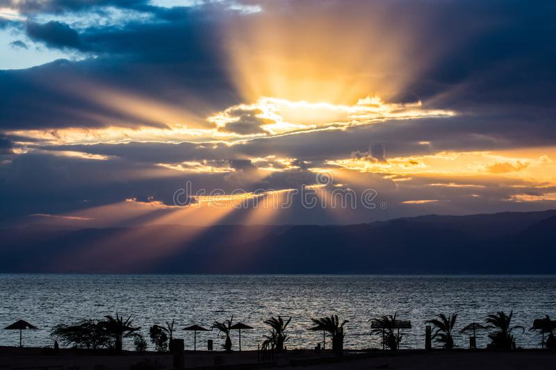 God rays and palms shadow above Red Sea, Gulf of Aqaba.  royalty free stock photography