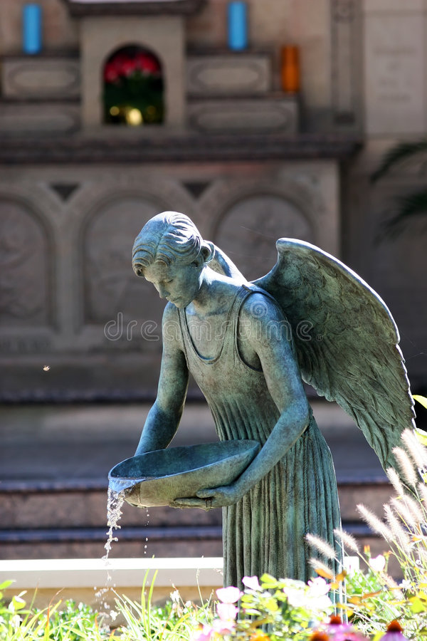 God's Angel pouring water stock images