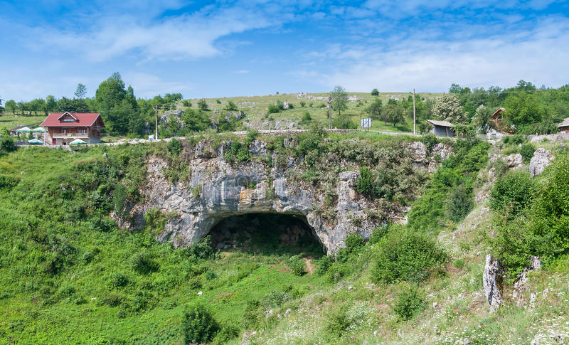 God's Bridge, a natural road bridge in Romania. God's Bridge, a natural bridge formed when the ceiling of a cave had collapsed, supports a natural road royalty free stock photo
