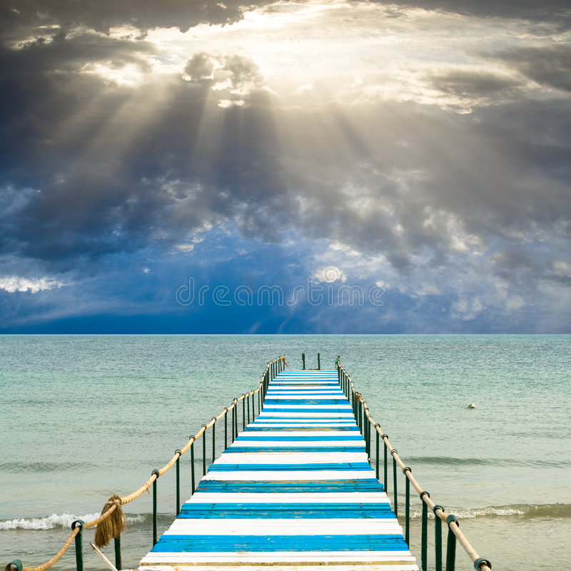 God's light is over a pier royalty free stock photo