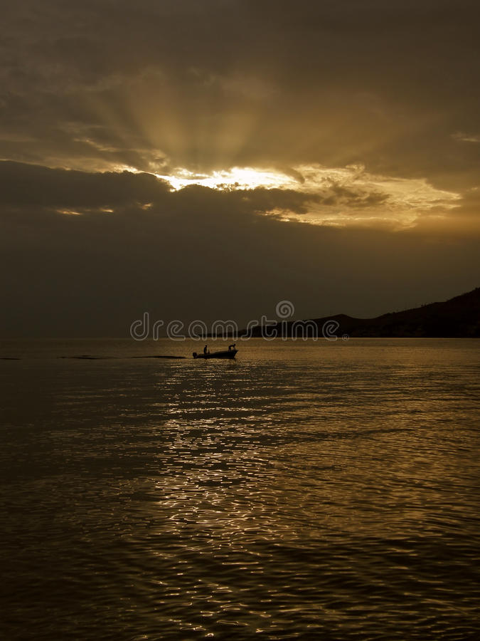 Gods Rays And  Boat Stock Image