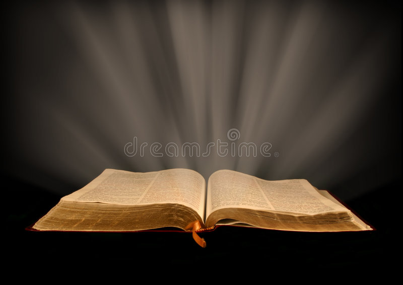 God's Word. Open Bible with rays of light