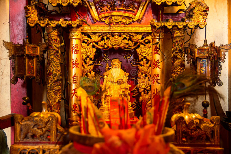 God statue in traditional old oriental chinese temple royalty free stock images