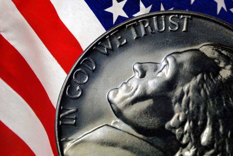 In God We Trust. Red, White, and Blue From American Flag Reflected in God We Trust Motto on Vintage, Retro, 1967 United States Nickel royalty free stock photography