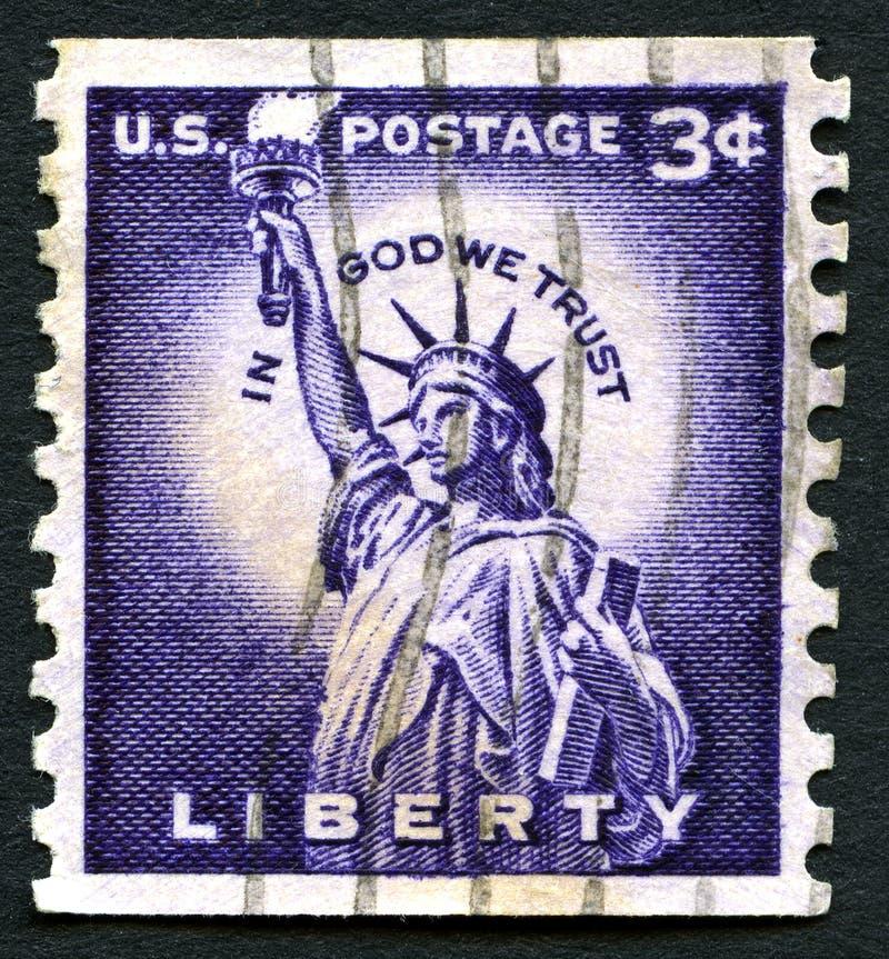 In God vertrouwen wij op de Postzegel van de V.S. stock afbeeldingen