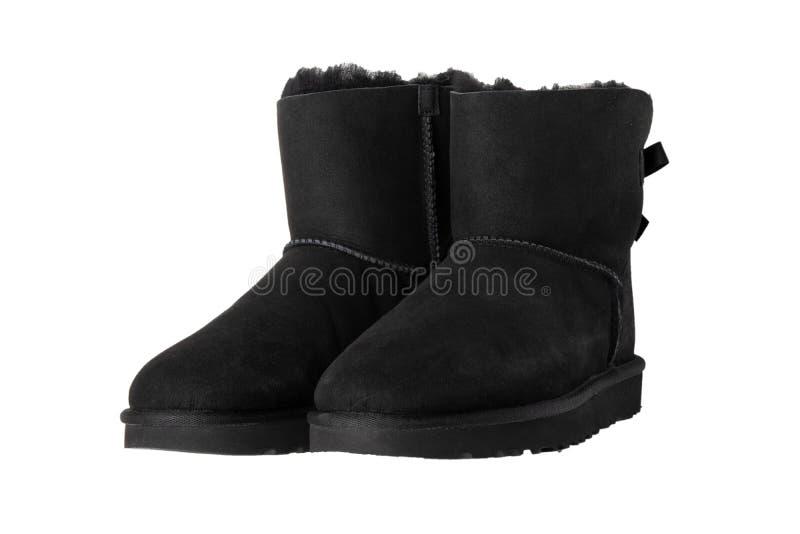 15 2008goda Listopad wycofujący Pary czerni zamszowy zimy rzemienni buty i wykładający z futerkiem pojedynczy białe tło Obuwiana  zdjęcia stock