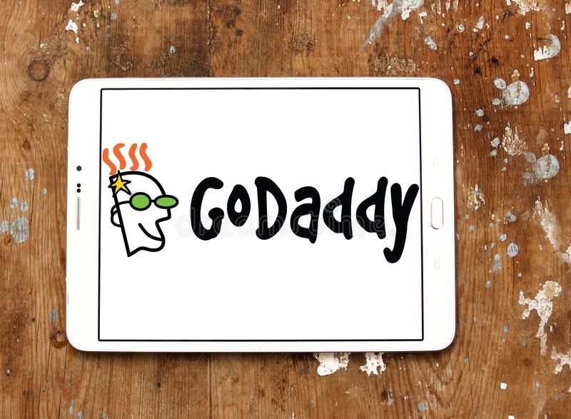 GoDaddy internet company logo. Logo of GoDaddy internet company on samsung tablet on wooden background. GoDaddy Inc. is an American publicly traded Internet stock photos