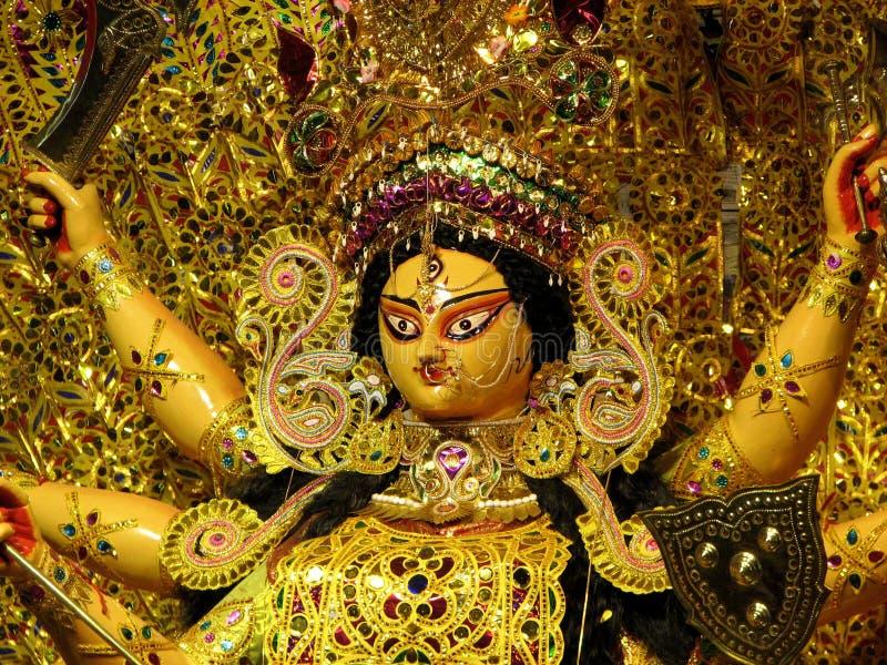 Goddess Durga. Golden portrait of the Hindu Goddess Durga, mother of the Universe, displayed at Kolkata, West Bengal, India royalty free stock images