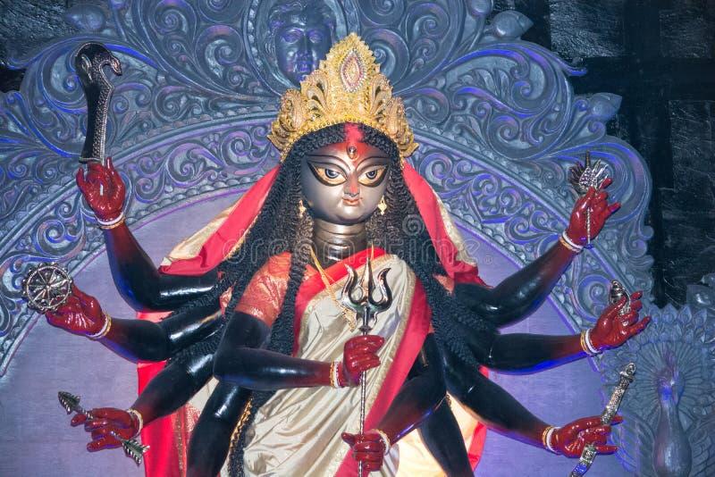 Goddess durga idol. An idol of hindu god durga curved out of clay shot during a festival in calcutta,india stock photos