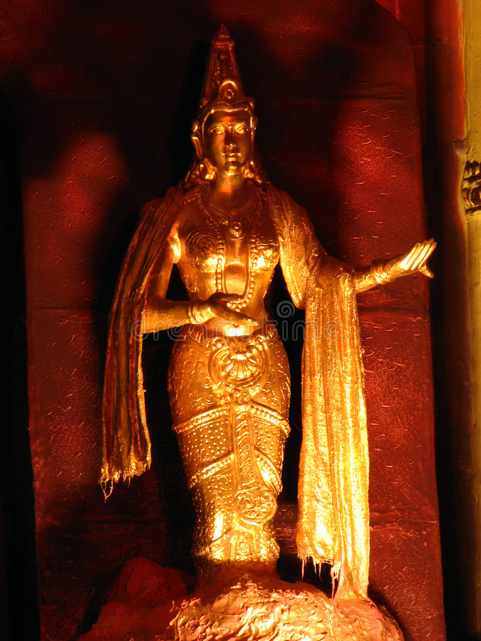 Goddess in Gold. A beautiful sculpture of a goddess in gold in an Indian temple stock photography