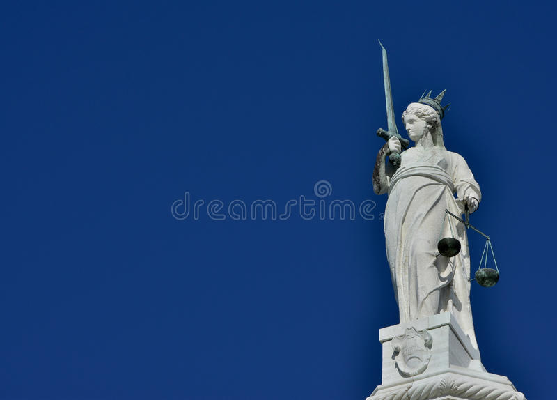 Goddess of Justice in Venice. Goddess of Justice statue with scales and sword, at the top of Doge Palace in Venice (with copy space) stock image
