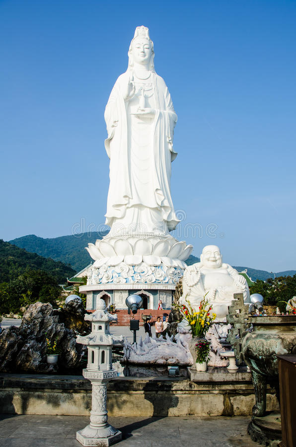 Goddess of Mercy and Budai at Linh Ung Pagoda in Da Nang, Vietnam. DANANG, VIETNAM FEBRUARY 10, 2015 Goddess of Mercy at Linh Ung Pagoda in Da Nang, Vietnam. The stock photos